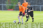 Park's David Courtney gets away from Tralee Dynamos Adam Pigott at Cahermoneen, Tralee on Sunday.