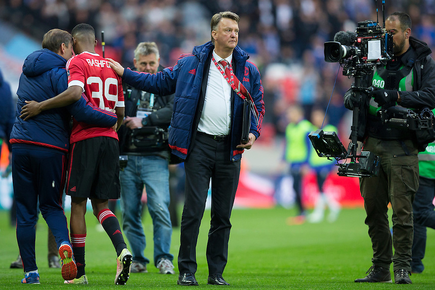 Manchester United's Marcus Rashford gets a pat on the back from Manchester United manager Louis van Gaal at full time<br /> <br /> Photographer Craig Mercer/CameraSport<br /> <br /> Football - The FA Cup Semi Final - Everton v Manchester United - Saturday 23rd April 2016 - Wembley - London<br /> <br /> &copy; CameraSport - 43 Linden Ave. Countesthorpe. Leicester. England. LE8 5PG - Tel: +44 (0) 116 277 4147 - admin@camerasport.com - www.camerasport.com