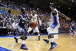 26 November 2014: Furman's Larry Wideman (left) is guarded by Duke's Quinn Cook (2) and Semi Ojeleye (right). The Duke University Blue Devils hosted the Furman University Paladins at Cameron Indoor Stadium in Durham, North Carolina in a 2014-16 NCAA Men's Basketball Division I game. Duke won the game 93-54.