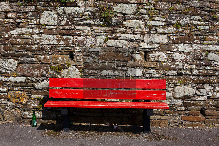 A bench and beer bottles outside the Timoleague Friary, a Franciscan friary in Timoleague, County Cork, Ireland.