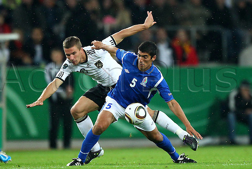 07.09.2010 Germany continued their smooth start to Euro 2012 qualifying with a comprehensive victory over Berti Vogts' Azerbaijan in Cologne. Picture shows Lukas Podolski against  Elnur Allahverdiyev.