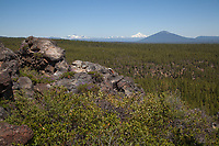view of distant volcanoes in central oregon, mt. washington and broken top in the deschutes national forest