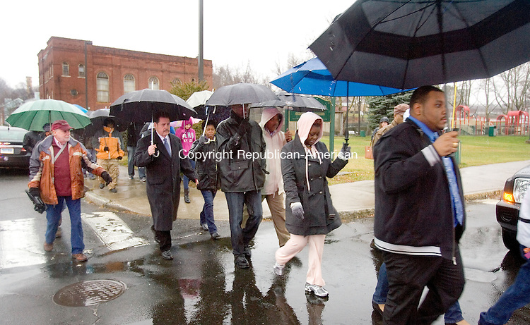 WATERBURY CT. 05 December 2014-120614SV13-About 40 people gathered despite the cold rain this afternoon for a rally and march from Martin Luther King Jr. Memorial Park in Waterbury Saturday. The march was for what they say is unfair treatment of black men across America. <br /> Steven Valenti Republican-American