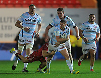 Racing 92 Finn Russell is tackled by Scarlets' Gareth Davies<br /> <br /> Photographer Ian Cook/CameraSport<br /> <br /> European Rugby Champions Cup - Scarlets v Racing 92 - Saturday 13th October 2018 - Parc y Scarlets - Llanelli<br /> <br /> World Copyright © 2018 CameraSport. All rights reserved. 43 Linden Ave. Countesthorpe. Leicester. England. LE8 5PG - Tel: +44 (0) 116 277 4147 - admin@camerasport.com - www.camerasport.com