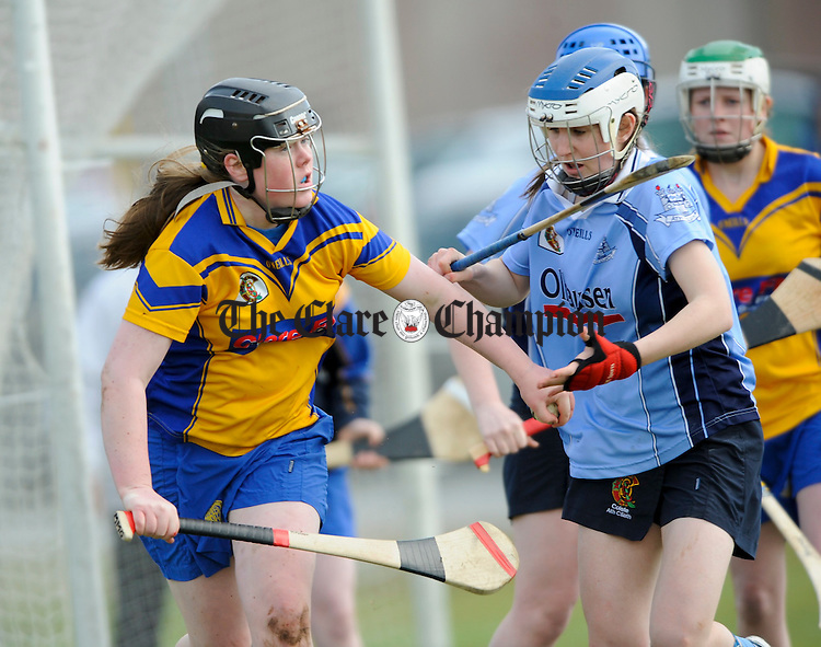 Clare's Moira Mc Grath moves away from Dublin's Clara Keane during their U-16 championship game at O Callaghan's Mills. Photograph by John Kelly.