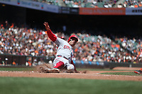 SAN FRANCISCO, CA - MAY 16:  Joey Votto #19 of the Cincinnati Reds slides home safely during the game against the San Francisco Giants at AT&T Park on Wednesday, May 16, 2018 in San Francisco, California. (Photo by Brad Mangin)