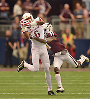 STAFF PHOTO BEN GOFF  @NWABenGoff -- 09/27/14 Arkansas wide receiver Kendrick Edwards catches a pass under pressure from Texas A&M cornerback De'Vante Harris during the first quarter of the Southwest Classic in AT&T Stadium in Arlington, Texas on Saturday September 27, 2014.