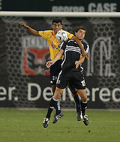 DC United forward Rod Dyachenko (15) tries to chest the ball while being covered by Monarcas Morelia defender Hugo Sanchez (20).  Monarcas Morelia tied DC United 1-1 in the SuperLiga opening match in group B, at RFK Stadium in Washington DC, Wednesday July 25, 2007.