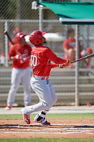 GCL Cardinals left fielder Angel Moreno (50) follows through on a swing during a game against the GCL Nationals on August 5, 2018 at Roger Dean Chevrolet Stadium in Jupiter, Florida.  GCL Cardinals defeated GCL Nationals 17-7.  (Mike Janes/Four Seam Images)