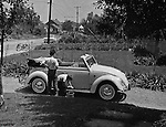 Bethel Park PA:  View of Michael Stewart washing the Stewart's new Volkswagen Beetle convertible - 1961.  Brady Stewart III is supervising the activity.