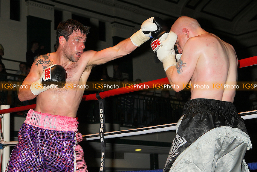 Phil Gill (purple shorts) defeats Damien Turner in a Light-Welterweight boxing contest at York Hall, Bethnal Green, promoted by Steve Goodwin - 11/09/10 - MANDATORY CREDIT: Gavin Ellis/TGSPHOTO - SELF-BILLING APPLIES WHERE APPROPRIATE. NO UNPAID USE. TEL: 0845 094 6026