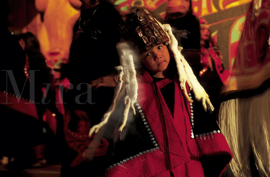 Portrait of a young Native Alaskan Tlingit dancer in traditional regalia clothing. Alaska.