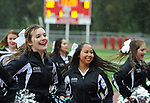 0871                              Megan Miles and the Eagle River cheerleaders perform in a rainstorm at halftime of the Wolves-Wasilla football game Friday, Aug. 18, 2017.  Photo for the Star by Michael Dinneen