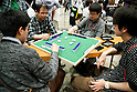 "Visitors play a card game at the Niconico Douga fan event at Makuhari Messe International Exhibition Hall on April 25, 2015, Chiba, Japan. The event includes special attractions such as J-pop concerts, Sumo and Pro Wrestling matches, cosplay and manga and various robot performances and is broadcast live on via the video-sharing site. Niconico Douga (in English ""Smiley, Smiley Video"") is one of Japan's biggest video community sites where users can upload, view, share videos and write comments directly in real time, creating a sense of a shared watching. According to the organizers more than 200,000 viewers for two days will see the event by internet. The popular event is held in all 11 halls of the huge Makuhari Messe exhibition center from April 25 to 26. (Photo by Rodrigo Reyes Marin/AFLO)"