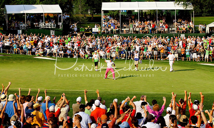 PGA golfer Jonathan Byrd reacts on the 18th green after sinking a four-foot putt to tie Lucas Glover at  the Wells Fargo Championship, a PGA championship event held annually in Charlotte NC. The event previously was called The Wachovia Golf Championship. The event is held at the Quail Hollow Club in Charlotte, North Carolina in early May. Since its inception in 2003, the PGA golf championship event has attracted some of the top players on the tour. In 2009, the tournament had a $6.5 million purse with a winner's prize of $1.17 million. The event is often ranked among the PGA Tour's toughest holes. The majority of the charitable proceeds from the tournament benefit Teach for America.