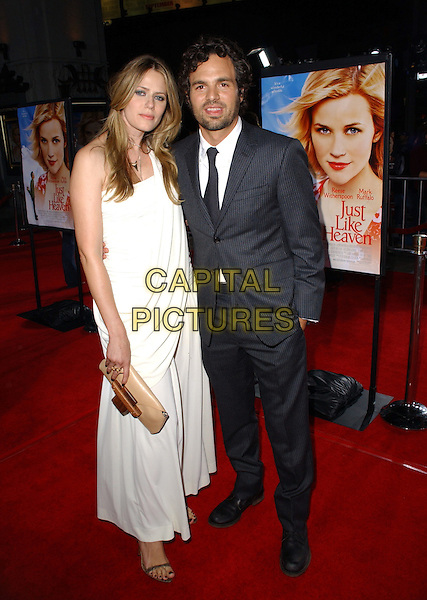 "MARK RUFFALO & SUNRISE RUFFALO.Dreamworks Pictures' Los Angeles Premiere of ""Just Like Heaven"" held at The Grauman's Chinese Theatre in Hollywood, California  .September 8th, 2005.full length married husband wife white dress brown clutch purse blue pinstripe suit .www.capitalpictures.com.sales@capitalpictures.com.Supplied By Capital PIctures"