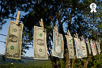 International money hanging on clothesline to dry (Licence this image exclusively with Getty: http://www.gettyimages.com/detail/sb10065474bp-001 )