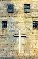 Cross on the wall of the Cathedral of Santiago de Compostela, Galicia, Spain.