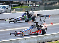 Jun 6, 2016; Epping , NH, USA; NHRA top fuel driver Todd Paton (near) defeats Brittany Force during the New England Nationals at New England Dragway. Mandatory Credit: Mark J. Rebilas-USA TODAY Sports