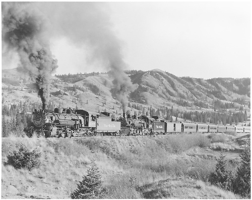 #488 and #499 hauling baggage car and 7 passenger cars.<br /> D&amp;RGW  Cumbres Pass, CO