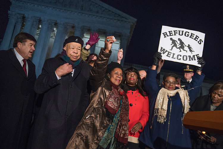UNITED STATES - JANUARY 30: From left, Reps. Dutch Ruppersberger, D-Md., Elijah Cummings, D-Md., Sheila Jackson Lee, D-Texas, Terri Sewell, D-Ala., Gwen Moore, D-Wis., and others members of the House and Senate gather in front of the Supreme Court to voice opposition to President Trump's executive order barring immigrants from certain countries entry into the U.S., January 30, 2017. (Photo By Tom Williams/CQ Roll Call)