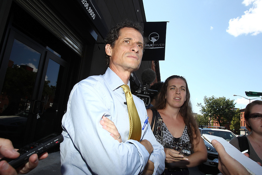 Anthony Weiner speaks to reporters after meeting with Caribbean small business owners at Milk River restaurant on Sunday, August 4, 2013 in Brooklyn, New York. (AP Photo/ Donald Traill)