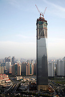 A view of the unfinished Shanghai World Financial Centre in Shanghai, China. Designed by the Japanese firm Mori Buildings, the building will be the tallest in Asia upon completion standing at 101 stories and 472 meters high..27 Apr 2007