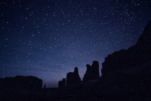 The night sky comes alive beyond Park Avenue at Arches National Park, Utah