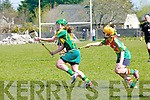 Alanna Maunsell (Kerry) in action with Laura James (Carlow) in the An Cumann Amógaíochta Minor (C)) All Ireland Championship Play off In Ardfert on Saturday.