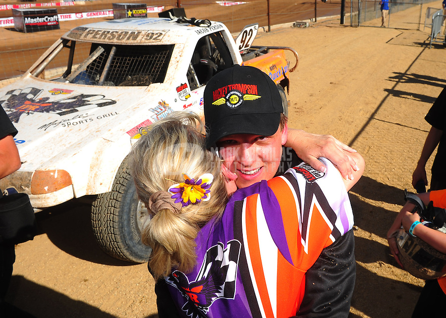 Apr 16, 2011; Surprise, AZ USA; LOORRS driver Jacob Person (92) celebrates with his mom after winning round 3 at Speedworld Off Road Park. Mandatory Credit: Mark J. Rebilas-.