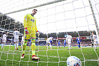 tDavid Stockdale of Birmingham City looks dejected as Craig Bryson of Cardiff City celebrates scoring his sides second goal of the match during he Sky Bet Championship match between Cardiff City and Birmingham City at the Cardiff City Stadium, Wales, UK. Saturday 10 March 2018