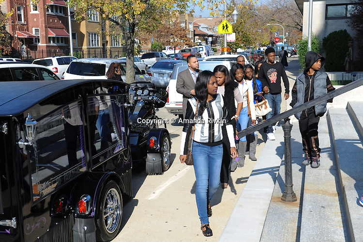 Mourners arrive for the funeral of Tyshawn Lee, 9, who was shot multiple times while playing basketball in an alley on November 2, 2015, at St. Sabina's in Chicago, Illinois on November 10, 2015. Police allege the killing was a retaliatory gang hit which would mark a new turn in Chicago's gang wars.