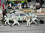 Carl Edwards, driver of the (99) Scotts Ford, makes a pit stop during the Samsung Mobile 500 Sprint Cup race at Texas Motor Speedway in Fort Worth,Texas.