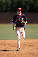 Shippensburg Raiders center fielder Cody Ezolt (6) jogs off the field between innings of the game against the Belmont Abbey Crusaders at Abbey Yard on February 8, 2015 in Belmont, North Carolina.  The Raiders defeated the Crusaders 14-0.  (Brian Westerholt/Four Seam Images)