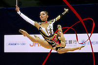 Ukrainian rhythmic group split leaps in unison  during 5-ribbons routine at 2006 Mie World Cup Finale of rhythmic gymnastics on November 17, 2006 at Mie, Japan.<br />