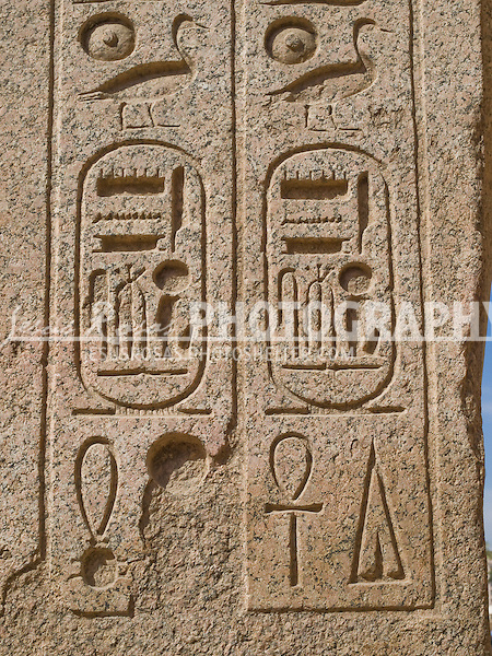 The cartouche was used as a nameplate with the shape of an oval encircling Egyptian symbols,  it is common to find cartouche hieroglyphics upon tombs of ancient Egyptian royalty and helped to identify the bodies who were buried there.