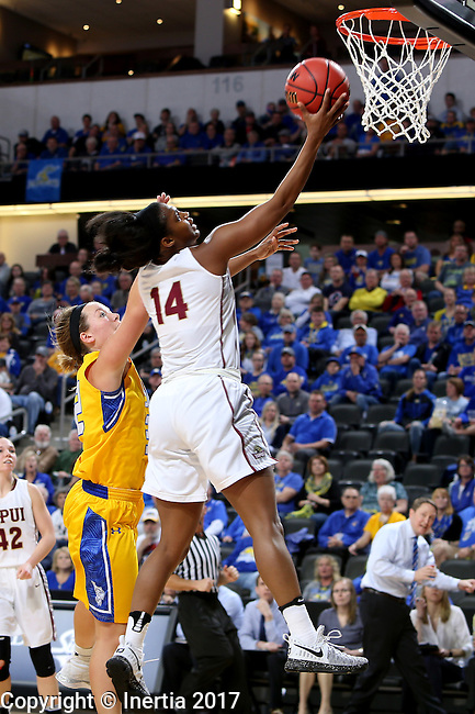 SIOUX FALLS, SD: MARCH 6: Danielle Lawrence #14 from IUPUI lays the ball up past Sydney Palmer #32 from South Dakota State during the Summit League Basketball Championship on March 6, 2017 at the Denny Sanford Premier Center in Sioux Falls, SD. (Photo by Dave Eggen/Inertia)