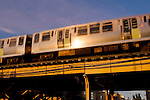 "The Chicago ""L"" train passes over a local street in Lincoln Park, Chicago, Illinois"