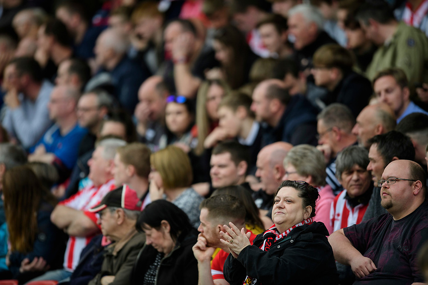 Lincoln City fans watch their team in action<br /> <br /> Photographer Chris Vaughan/CameraSport<br /> <br /> The EFL Sky Bet League Two - Lincoln City v Macclesfield Town - Saturday 30th March 2019 - Sincil Bank - Lincoln<br /> <br /> World Copyright © 2019 CameraSport. All rights reserved. 43 Linden Ave. Countesthorpe. Leicester. England. LE8 5PG - Tel: +44 (0) 116 277 4147 - admin@camerasport.com - www.camerasport.com