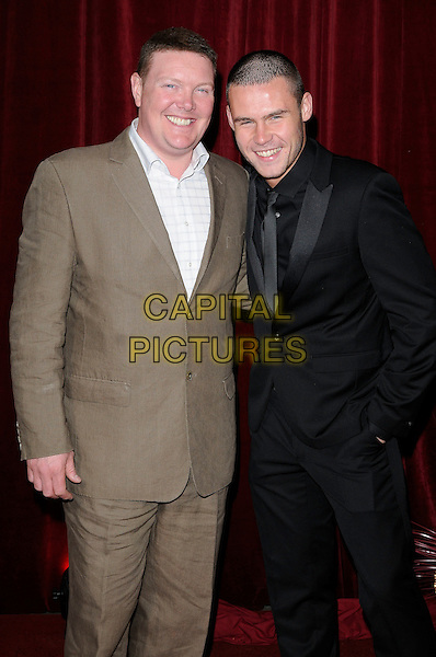 GUESTS .Attending The British Soap Awards 2010, The London Television Centre, London, England, UK, 8th May 2010 .arrivals half length brown black suit smiling tie .CAP/CAN.©Can Nguyen/Capital Pictures.