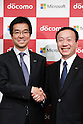 November 1, 2012, Tokyo, Japan - Yasuyuki Higuchi, left, president and CEO of Microsoft Japan, shakes hands with Kaoru Kato, president of Japan's NTT DoCoMo, during a news conference in Tokyo on Thursday, November 1, 2012. DoCoMo, Japan's leading cellular phone carrier, and Microsoft Japan have agreed to work together aiming to incorporate Windows 8-powered tablet computers with DoCoMo's extra high speed LTE mobile service in the corporate computer market. (Photo by AFLO) UUK -mis-