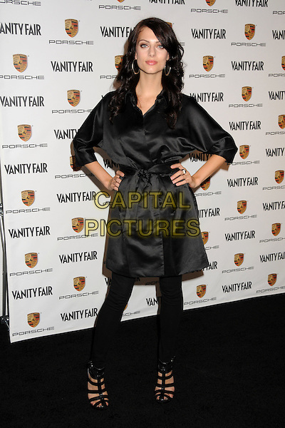 JULIA VOTH .Porche and Vanity Fair Celebrate the Launch of the Porche Panamera at Milk Studios, Los Angeles, California, USA..September 24th, 2009.full length black silk satin belted trench coat hands on hips sandals leggings .CAP/ADM/BP.©Byron Purvis/AdMedia/Capital Pictures.