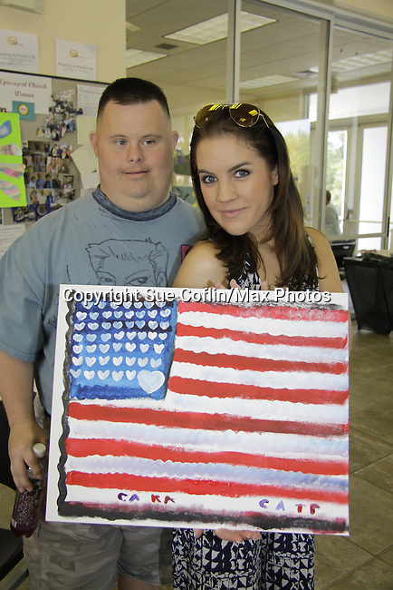 Troy and Kristen Alderson paing American Flag as it is Memorial Day Weekend at 15th Soapfest 2014 painting party on May 24, 2104 gathered together to do paintings with guests and the proceeds went to charity - The weekend of events is held on Marco Island, Florida.  (Photo by Sue Coflin/Max Photos)
