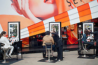 """A Sephora pop-up shop in the trendy Meatpacking District in New York is seen on Saturday, March 24, 2012. The store, a partnership with Sephora and Pantone promotes the """"Tangerine Tango"""" line of products. The color is the official hue of 2012 chosen by Pantone based on their studies of color trends.  (© Richard B. Levine)"""