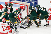 Continued battle for the puck which was moved to the front of the net before being pushed in by Jill Cardella (BU - 22). - The Boston University Terriers tied the visiting University of Vermont Catamounts 2-2 on Saturday, November 13, 2010, at Walter Brown Arena in Boston, Massachusetts.
