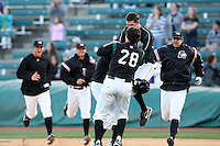April 10, 2010:  Miles Durham (28) and Jordy Mercer (in air) of the Altoona Curve jump on Jose L de los Santos after he had the game winning hit to score Josh Harrison in the 10th inning during a game at Blair County Ballpark in Altoona, PA.  Dustin Molleken (right), Michael Dubee (center back) and an unidentified player join the celebration.  Photo By Mike Janes/Four Seam Images