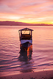 INDONESIA, Flores, Riung, sunset reflecs off of the Flores Sea, Rutong island