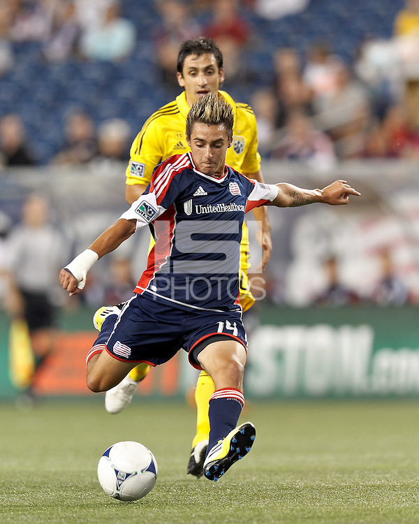 New England Revolution forward Diego Fagundez (14) takes a shot. In a Major League Soccer (MLS) match, the New England Revolution defeated Columbus Crew, 2-0, at Gillette Stadium on September 5, 2012.