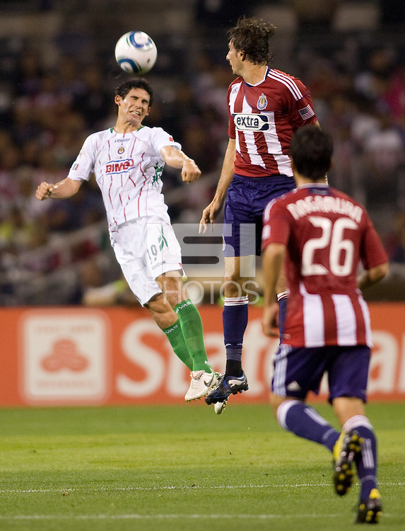 Chivas de Guadalajara defender Jonny Magallon leaps high for a ball. Chivas USA forwardLos CD Chivas  vs  at Petco Park stadium in San Diego, California on Tuesday September 14, 2010.