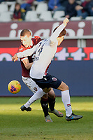 12th January 2020; Olympic Grande Torino Stadium, Turin, Piedmont, Italy; Serie A Football, Torino versus Bologna; Andrea Belotti of Torino FC struggles for possession with Takehiro Tomiyasu of Bologna FC - Editorial Use